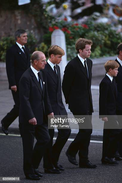 Philip Duke of Edinburgh Prince William Earl Spencer and Prince Harry walk behind Diana's casket during the funeral procession of Diana Princess of...