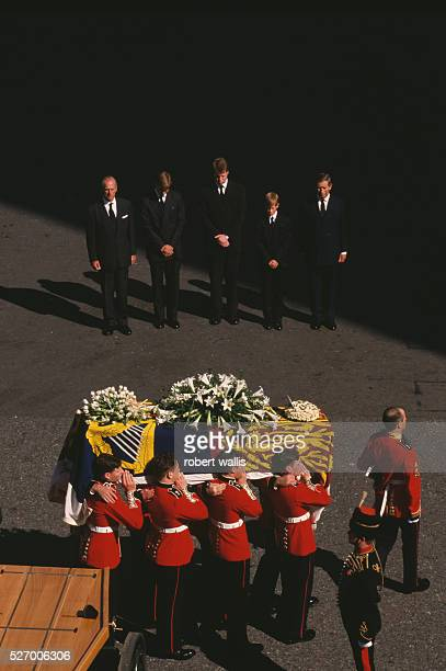 Philip Duke of Edinburgh Prince William Earl Spencer Prince Harry and Charles Prince of Wales bow their heads behind Diana's casket during the...