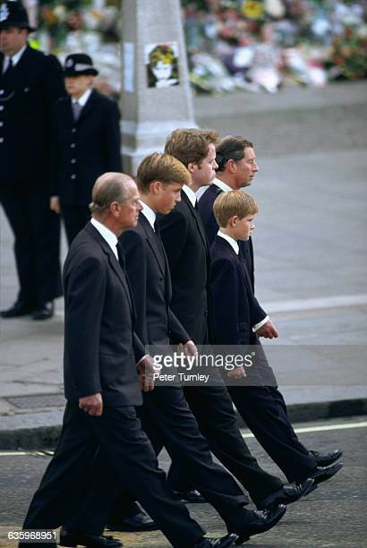 Philip Duke of Edinburgh Prince William Earl Spencer Prince Harry and Charles Prince of Wales walk behind Diana's casket during the funeral...