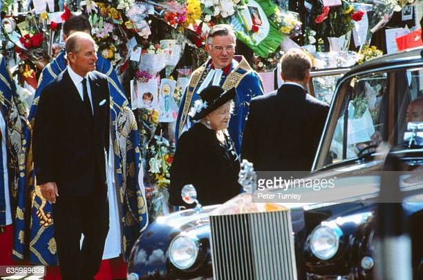 Philip Duke of Edinburgh stands behind Elizabeth The Queen Mother as she gets into an automobile at the funeral of Diana Princess of Wales only seven...