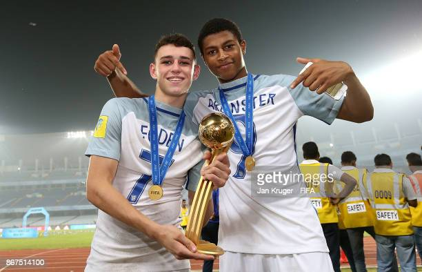 Philip Foden and Rhian Brewster of England pose after victory during the FIFA U-17 World Cup India 2017 Final match between England and Spain at...