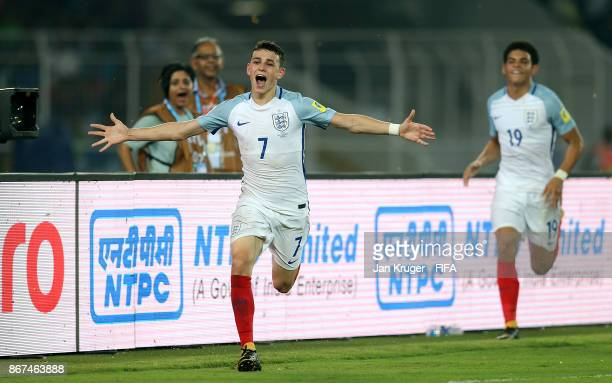 Philip Foden of England celebrates scoring the 3rd goal during the FIFA U17 World Cup India 2017 Final match between England and Spain at Vivekananda...