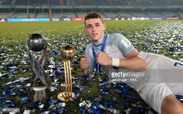 Philip Foden of England poses with the winners trophy and best young player trophy during the FIFA U17 World Cup India 2017 Final match between...