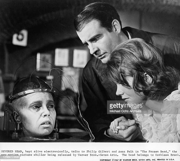Philip Gilbert And Anna Palk talking to severed head in a scene from the film 'The Frozen Dead' 1967