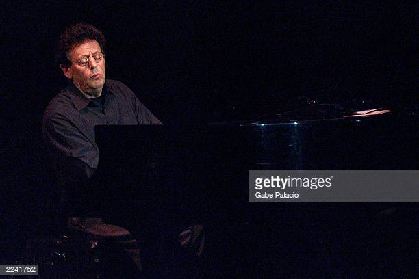 Philip Glass performing on the piano during the Tibet House Benefit Concert 2001 with artistic director Philip Glass Dana Bryant Emmylou Harris Patti...