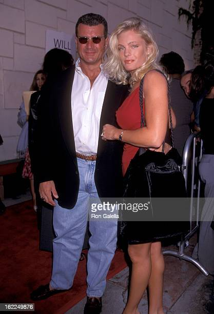 Philip Goglia and Erika Eleniak attend the premiere of Love Stinks on August 11 1999 at Mann Festival Theater in Westwood California