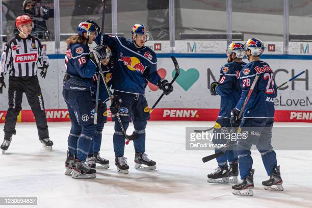 Philip Gogulla of EHC Red Bull Muenchen celebrates after scoring his team's 1:1 goal with his team mates during the DEL match between EHC Red Bull...