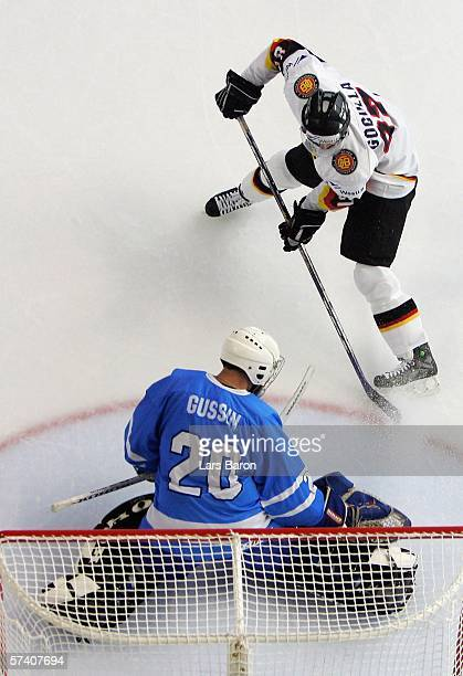 Philip Gogulla of Germany is stopped by goalie Jevgeny Gusin of Israel during the IIHF World Championship Division 1 Group A match between Germany...