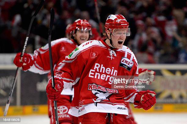 Philip Gogulla of Koeln celebrates after scoring the winning goal in game five of the DEL playoffs between Koelner Haie and Straubing Tigers at...