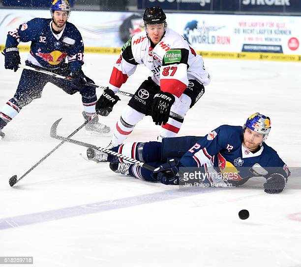 Philip Gogulla of the Koelner Haien and Mads Christensen of EHC Red Bull Muenchen during the game between the EHC Red Bull Muenchen and Koelner Haie...
