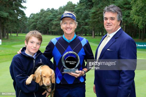Philip Golding of England in poses with the Duke of Bedford and his son after the final round of the Travis Perkins Senior Masters played at the...