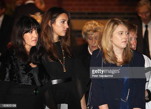Philip Gould's widow Gail Rebuck stands with her daughters Grace and Georgia Gould as the coffin is taken from All Saints church on November 15 2011...