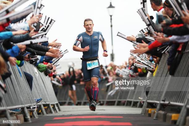Philip Graves of Great Britain finishes second in the Men's race during the Ironman Wales competiton on September 10 2017 in Tenby Wales