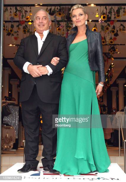 Philip Green, the billionaire owner of Arcadia Group Ltd., and model Kate Moss, greet the media and awaiting crowds at the opening of the Topshop...