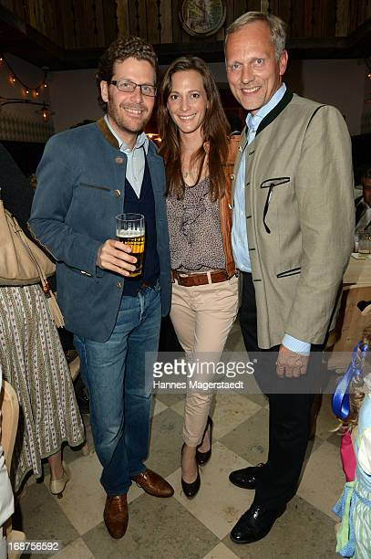 Philip Greffenius and his wife Evelyn and Martin Kolonko attend the 'Tegernsee Tal Braeuhaus' Opening on May 14 2013 in Munich Germany