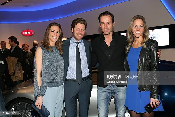 Philip Greffenius and his wife Evelyn Greffenius Sven Hannawald and his girlfriend Melissa Thieme during the Bugatti boutique opening on March 17...