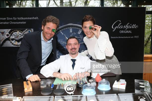Philip Greffenius Edition Sportiva and his wife Evelyn Greffenius with a watchmaker during the piano night hosted by Wempe and Glashuette Original at...