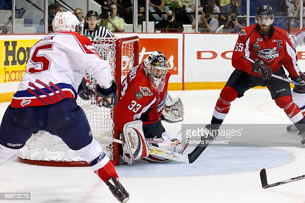 Philip Grubauer of the Windsor Spitfires stops the puck on a shot by Marek Hrivik of the Moncton Wildcats during the 2010 Mastercard Memorial Cup...