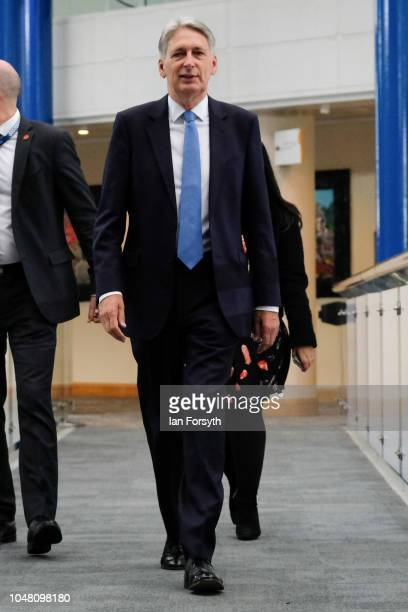 Philip Hammond Chancellor of the Exchequer walks through the International Convention Centre on day three of the Conservative Party Conference on...