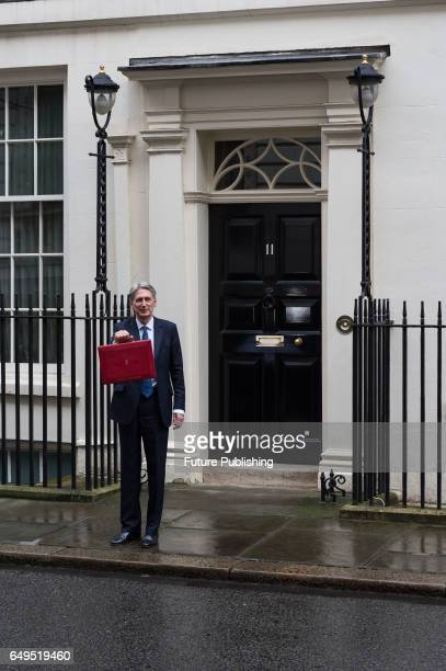 Philip Hammond the Chancellor of the Exchequer leaves 11 Downing Street to deliver his first Spring Budget to the House of Commons on March 08 2017...