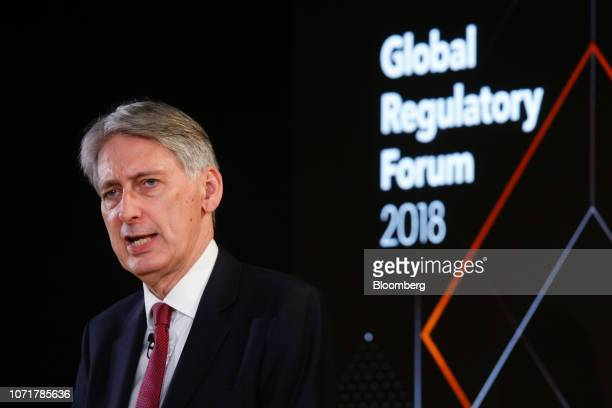 Philip Hammond UK chancellor of the exchequer delivers a speech during the Global Regulatory Forum at Bloomberg's European headquarters in London UK...