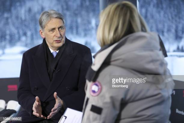 Philip Hammond UK chancellor of the exchequer gestures as he speaks during a Bloomberg Television interview on the closing day of the World Economic...