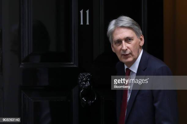 Philip Hammond UK chancellor of the exchequer leaves number 11 Downing Street in London UK on Wednesday Jan 10 2018 The UK economy will be paying the...
