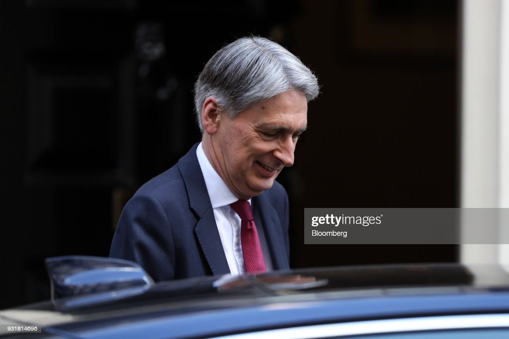 Philip Hammond, U.K. chancellor of the exchequer, leaves number 11 Downing Street in London, U.K., on Wednesday, March 14, 2018. Prime Minister Theresa May publicly blamed Russia for poisoning a former spy and his daughter on British soil, as escalating tension between the Kremlin and the West raised fears of a new Cold War. Photographer: Simon Dawson/Bloomberg via Getty Images
