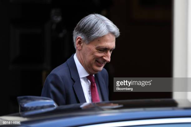 Philip Hammond UK chancellor of the exchequer leaves number 11 Downing Street in London UK on Wednesday March 14 2018 Prime...
