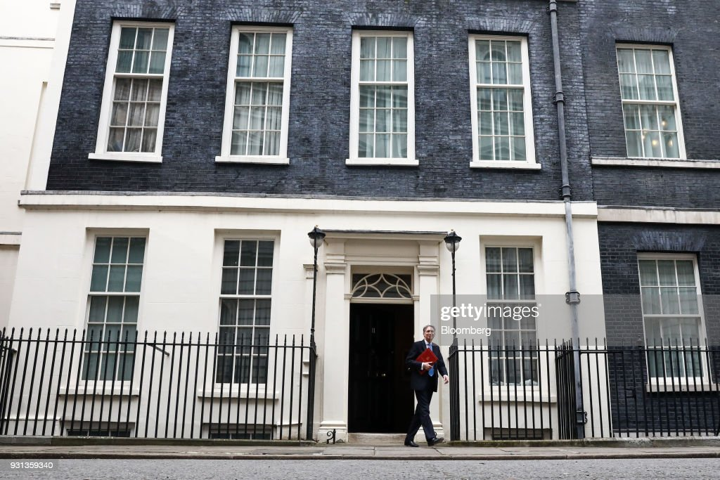 Philip Hammond, U.K. chancellor of the exchequer, leaves number 11 Downing Street to present the Spring Statement in Parliament in London, U.K., on Tuesday, March 13, 2018. This yearHammondhas decided to do things differently, moving the main Budget announcement to the Autumn and reducing the Spring Statement one to a handful of forecasts on the shape of the economy that will last less than half an hour. Photographer: Simon Dawson/Bloomberg via Getty Images