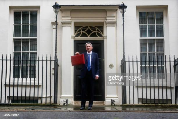 Philip Hammond UK chancellor of the exchequer poses for photographers as he holds the dispatch box containing the budget as he exits 11 Downing...