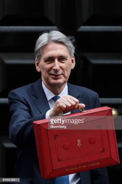 Philip Hammond UK chancellor of the exchequer poses for photographers holding the dispatch box containing the budget as he exits 11 Downing Street on...