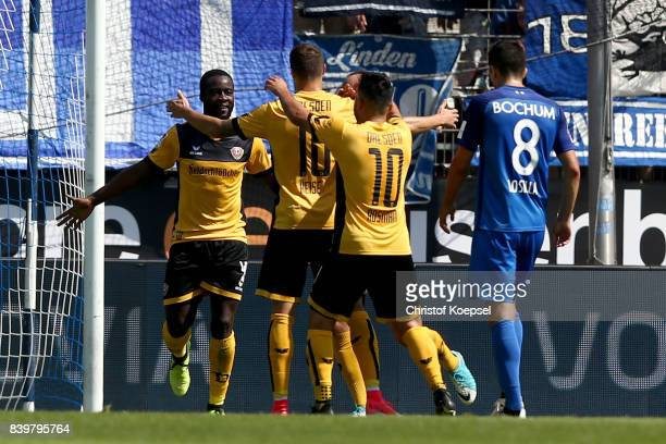 Philip Heise Of Dresden celebrates the first goal with Erich Berko and Aias Aosman during the Second Bundesliga match between VfL Bochum 1848 and SG...