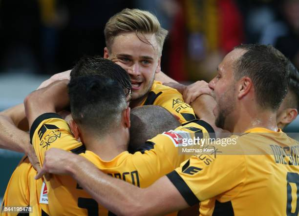 Philip Heise of Dresden jubilates with team mates after scoring the first goal during the Second Bundesliga match between SG Dynamo Dresden and SpVgg...
