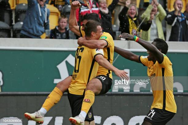 Philip Heise of Dynamo Dresden Aias Aosman of Dynamo Dresden and Moussa Kone of Dynamo Dresden celebrate a goal during the Second Bundesliga match...