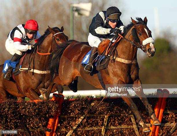 Philip Hide and First Avenue clear the last flighjt before landing The totesuper7 Handicap Hurdle Race run at Huntingdon Racecourse on December 10...