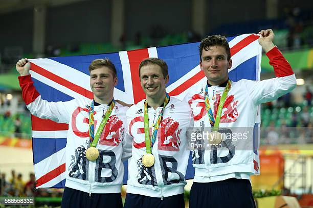 Philip Hindes Jason Kenny and Callum Skinner of Great Britain celebrate after winning gold and getting an Olympic record in the Men's Team Sprint...