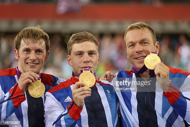 Philip Hindes, Jason Kenny and Sir Chris Hoy of Great Britain celebrate with their gold medals during the medal ceremony after setting a new world...