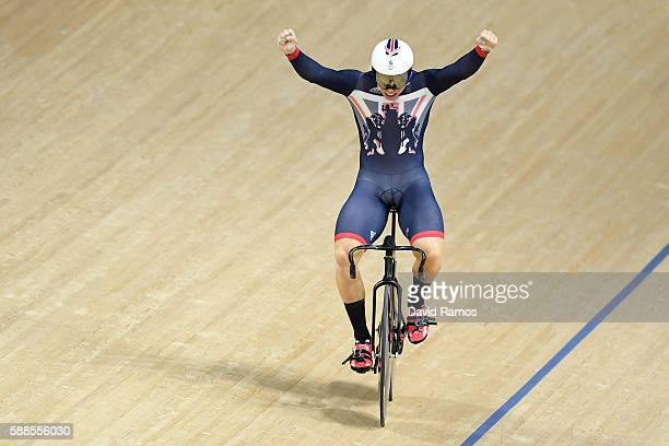 Philip Hindes of Great Britain celebrates after wining gold in the Men's Team Sprint Track Cycling Finals on Day 6 of the 2016 Rio Olympics at Rio...