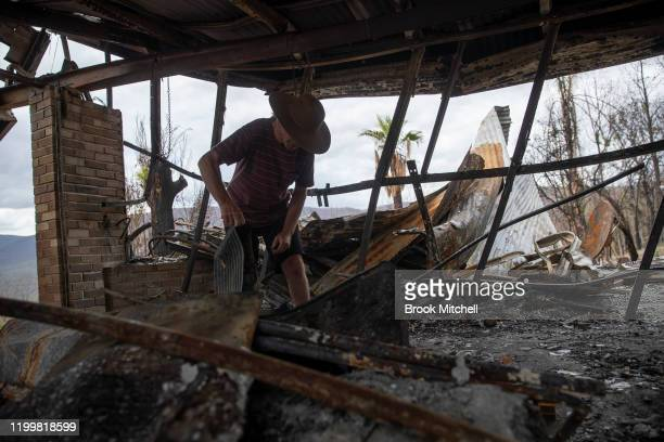 Philip Hine surveys the ruins of his property in Wytaliba on January 14 2020 in Wytaliba Australia On the afternoon of November 8 firestorms ripped...
