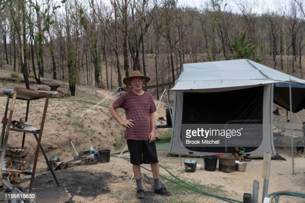 Philip Hine surveys the ruins of his property on January 14 2020 in Wytaliba Australia Philip narrowly escaped the inferno that tore through the area...