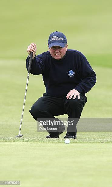Philip Hinton of Chesterton Valley Golf Club lines up a putt on the 2nd green during the Senior PGA Professional Championship at Northamptonshire...