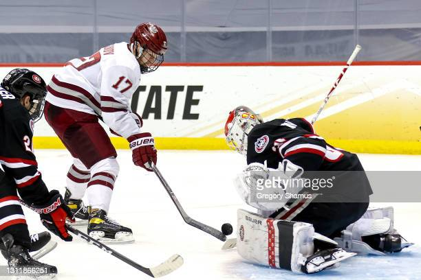 Philip Lagunov of the Massachusetts Minutemen scores a goal past David Hrenak of the St. Cloud St. Huskies during the second period in the Division I...