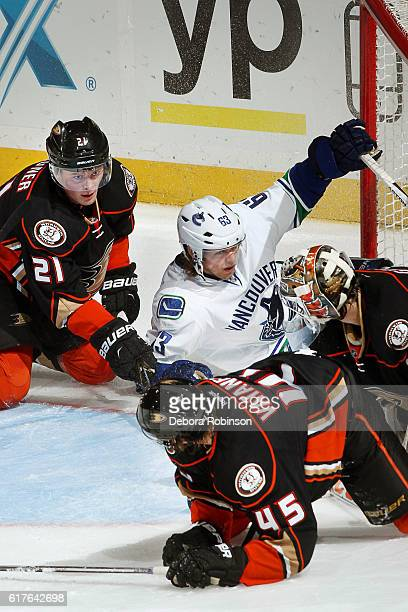 Philip Larsen of the Vancouver Canucks battles in front of the net against Chris Wagner Sami Vatanen and John Gibson of the Anaheim Ducks on October...