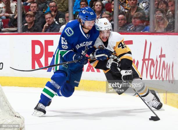 Philip Larsen of the Vancouver Canucks checks Conor Sheary of the Pittsburgh Penguins during their NHL game at Rogers Arena March 11, 2017 in...