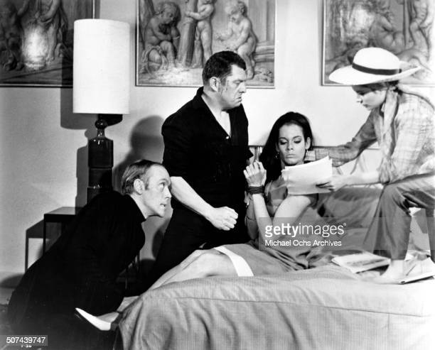 Philip Locke Michael Brennan and Luciana Paluzzi persuade Martine Beswick in a scene from the movie Thunderball circa 1965