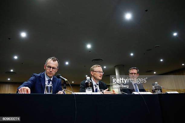 Philip Lowe governor of the Reserve Bank of Australia center speaks as Christopher Kent assistant governor left and Guy Debelle deputy governor...