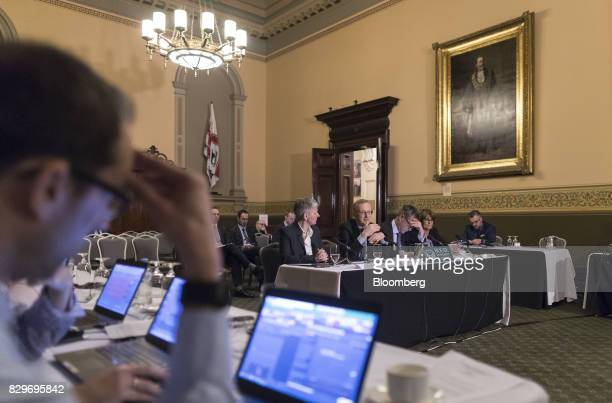 Philip Lowe governor of the Reserve Bank of Australia center speaks during a hearing before the House of Representatives economics committee in...