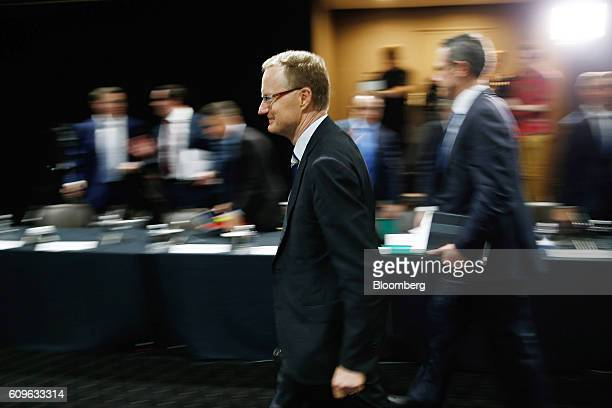 Philip Lowe governor of the Reserve Bank of Australia leaves a hearing before the House of Representatives economics committee in Sydney Australia on...
