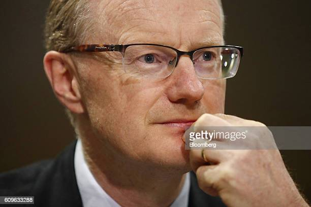 Philip Lowe governor of the Reserve Bank of Australia listens during a hearing before the House of Representatives economics committee in Sydney...